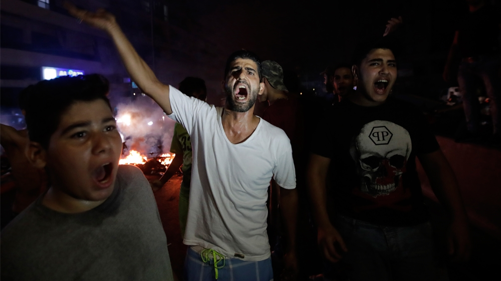 LEBANON-INTERNET-BUDGET-DEMO  Lebanese demonstrators chant slogans during a protest against recent tax calls on October 17, 2019 in the southern suburbs of Beirut.
