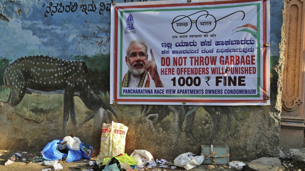 Garbage lies under a banner that reads