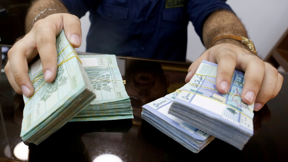 A money exchange vendor displays Lebanese pound banknotes at his shop in Beirut, Lebanon, August 16, 2018