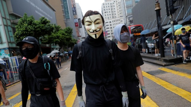 Masked anti-government protesters attend a demonstration in Tsim Sha Tsui district, in Hong Kong