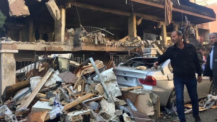 A man walks past a damaged building in Mezzah, Damascus, Syria November 12, 2019. REUTERS/Omar Sanadiki