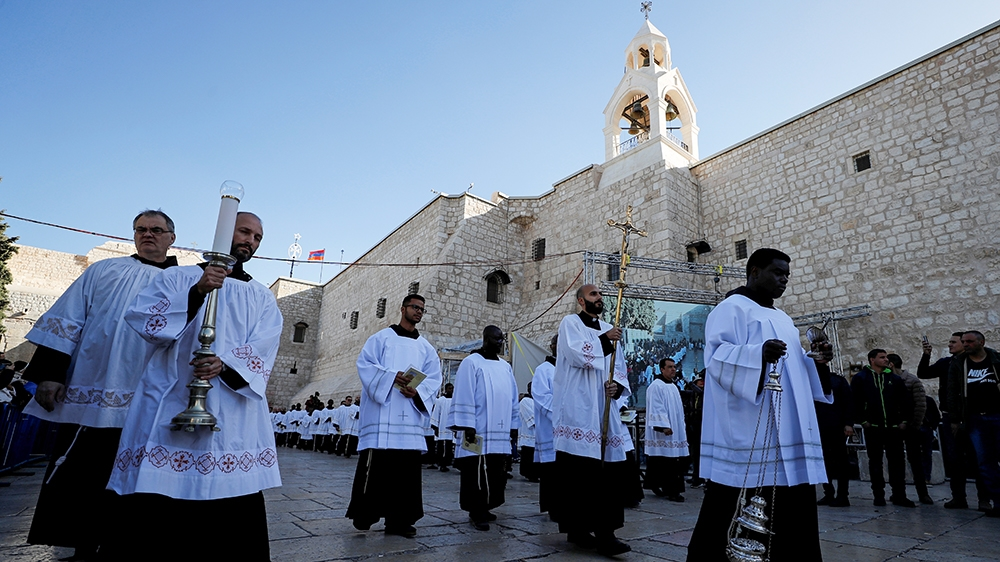 Clergymen attend Christmas celebrations at Manger Square outside the Church of the Nativity in Bethlehem, in the Israeli-occupied West Bank December 24, 2019. REUTERS/Ammar Awad