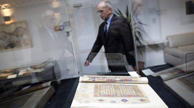 Jahic, director of Gazi Husrev-bey library walks past an old book displayed in Sarajevo