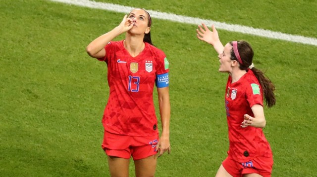 Alex Morgan of the U.S. celebrates scoring their second goal with Rose Lavelle