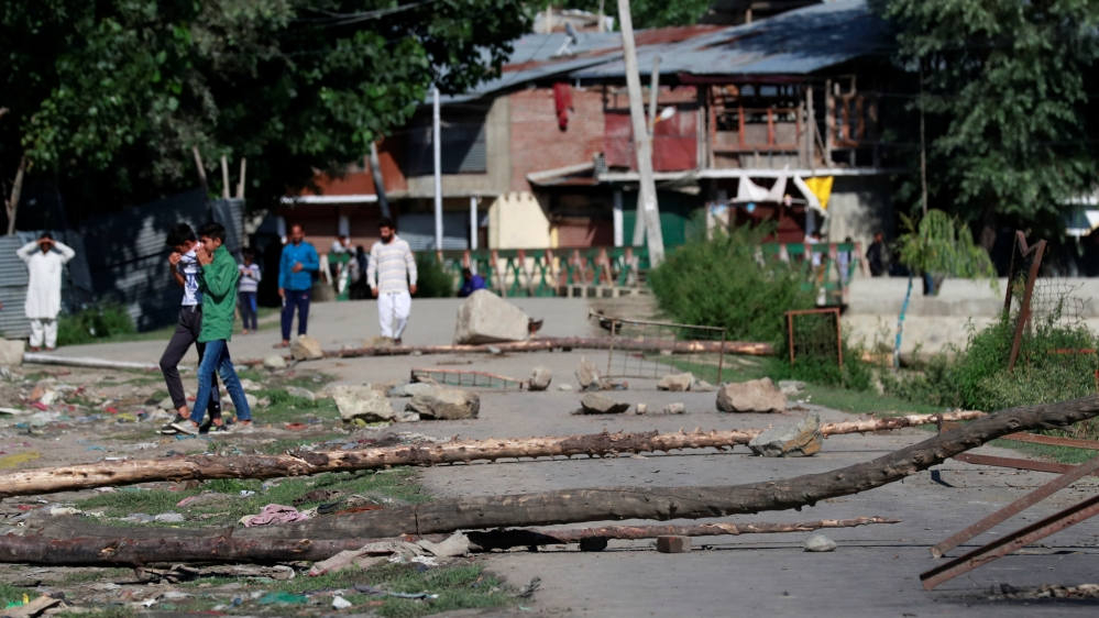A neighbourhood street is blocked with tree branches by Kashmiri protesters during restrictions after the scrapping of the special constitutional status for Kashmir by the government, in Srinagar
