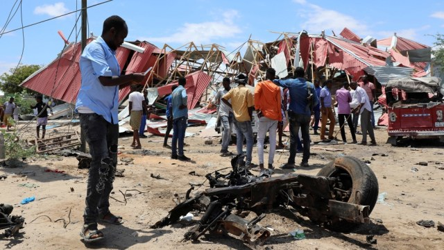 Somalis inspect the damage caused at the scene of an attack on an Italian military convoy in Mogadishu, Somalia September 30, 2019. REUTERS/Feisal Omar