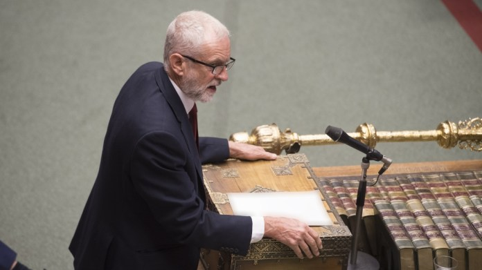 A handout photo made available by the UK Parliament shows Labour opposition leader Jeremy Corbyn gesturing during Prime Ministers Questions (PMQS)