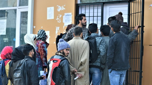 People queue up to go online at a government set-up internet cafe in Budgam, Kashmir