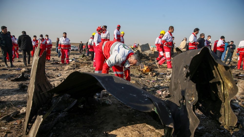 Red Crescent workers check the debris from the Ukraine International Airlines plane on the outskirts of Tehran, Iran January 8. Nazanin Tabatabaee/WANA