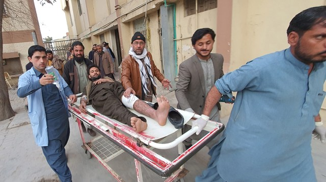 epa08223851 A man who was injured in a bomb blast is shifted to a hospital in Quetta, Pakistan, 17 February 2020. According to reports, at least 10 people were killed and more than 30 injured when a b