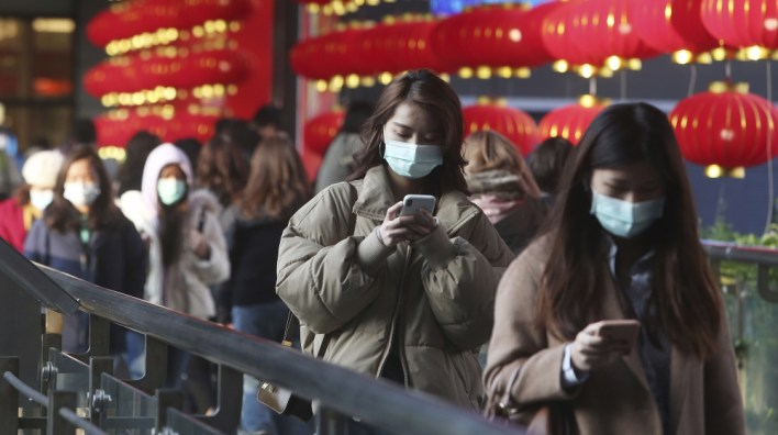 ISO Certificate People wear face masks as they walk through a shopping mall in Taipei, Taiwan [Chiang Ying-ying/AP Photo]