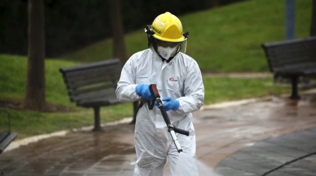 An Israeli firefighter sprays disinfectant as a precaution against the coronavirus in Modi'in, Israel, Tuesday, March 17, 2020. The head of Israel's shadowy Shin Bet internal security service said Tue