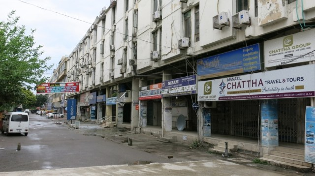 Islamabad's normally busy Blue Area market lies abandoned on Wednesday, as authorities mandated that only stores selling essential food and medicines could remain open