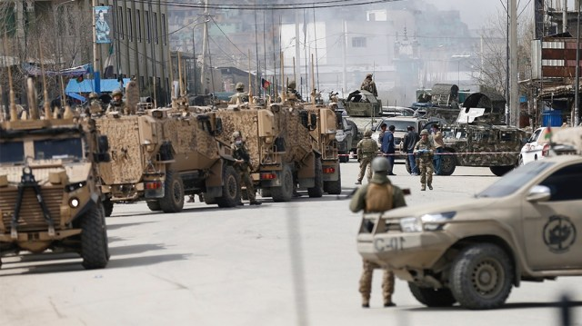 Afghan security forces inspect near the site of an attack in Kabul, Afghanistan March 25, 2020.REUTERS/Mohammad Ismail