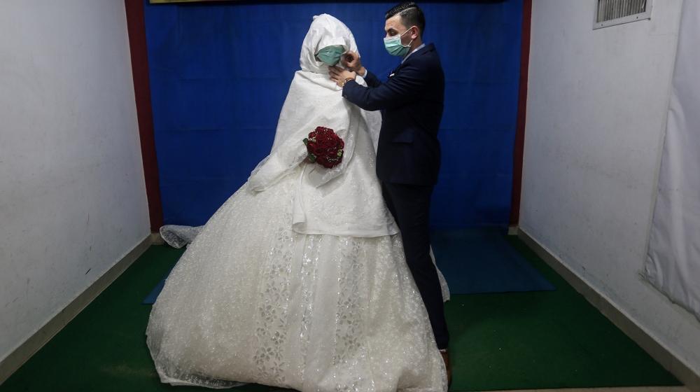 Coronavirus wedding story [Hana Salah/Al Jazeera]