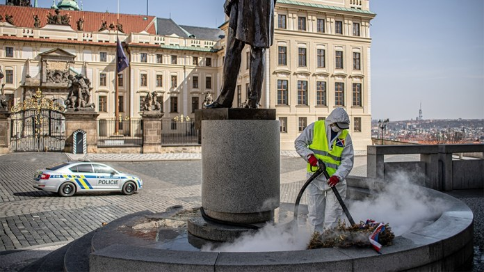 epa08326418 A worker in a protective suit disinfects the statue of first Czechoslovak President T. G. Masaryk at Hradcanske Square in Prague, Czech Republic, 27 March 2020. The Czech government has im