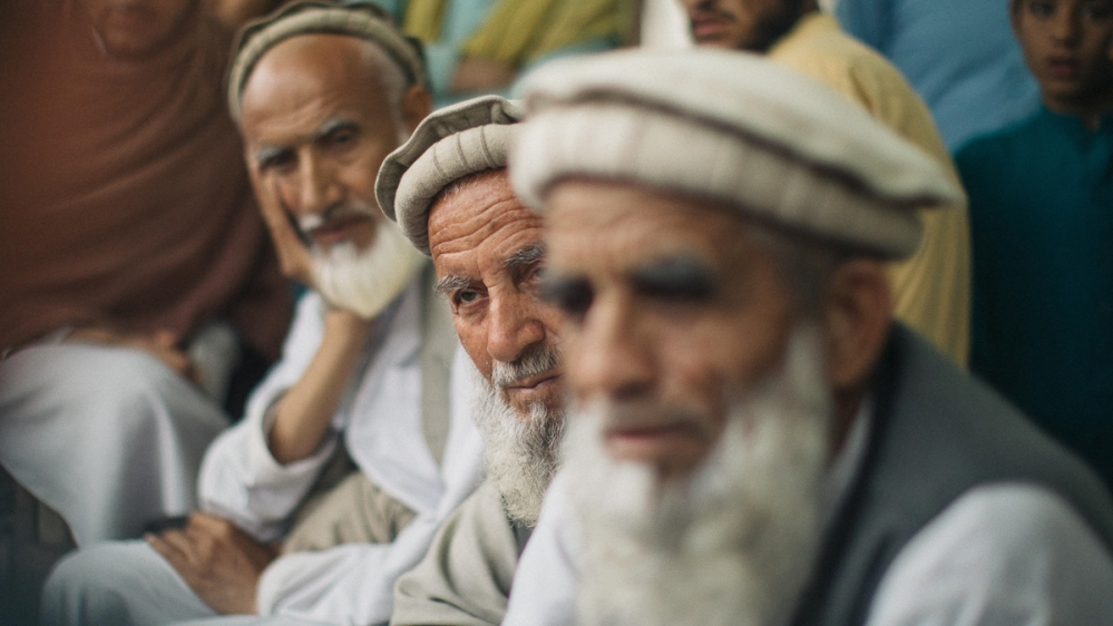 Village elders in Garbawa [Maciej Stanik/Al Jazeera]