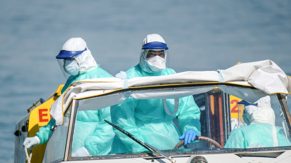 Health workers arrive by boat ambulance at a Venice hospital on Good Friday as Italy celebrates Easter under lockdown to try and stop the spread of the coronavirus disease (COVID-19) April 10, 2020. R