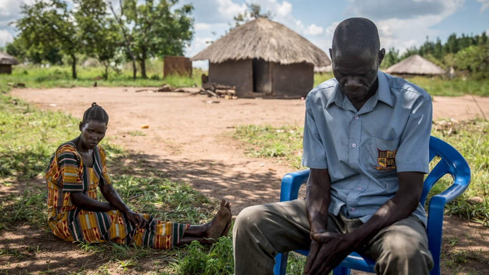 Jeanette Aromorach and Hillary Daniel Lagen, the parents of a 12-year-old who died after he was unable to reach hospital because of Uganda's transport ban. [Sally Hayden/Al Jazeera]