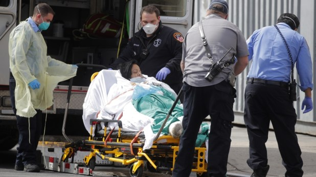 EMT's transport patient into Bronx-Lebanon Hospital during outbreak of coronavirus disease (COVID-19) in the Bronx borough of New York