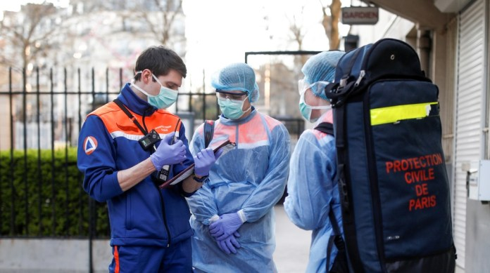 Members of the French Civil Protection service arrive on site for a rescue operation in Paris, as the spread of the coronavirus disease (COVID-19) continues in France, April 4, 2020. Picture taken Apr