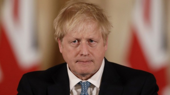 British Prime Minister Boris Johnson gives a press conference about the ongoing situation with the COVID-19 coronavirus outbreak inside 10 Downing Street in London, Tuesday, March 17, 2020. For most p