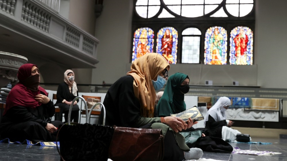 Muslims pray inside the evangelical church of St. Martha's parish, during their Friday prayers, as the community mosque can't fit everybody in due to social distancing rules,