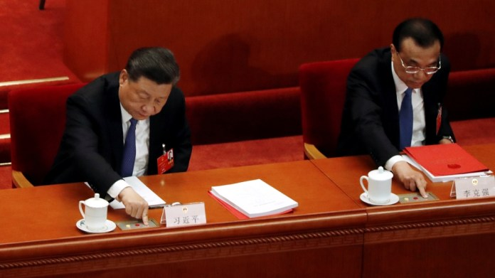 Chinese President Xi Jinping and Premier Li Keqiang cast their votes on the national security legislation for Hong Kong Special Administrative Region at the closing session of NPC in Beijing
