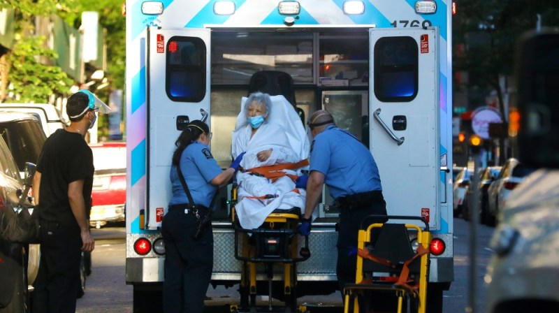 A elderly woman is transported into an ambulance on Manhattan's west side in New York, New York, USA, 22 June 2020. New York State Governor Cuomo continued to urge caution, particularly as many as 19