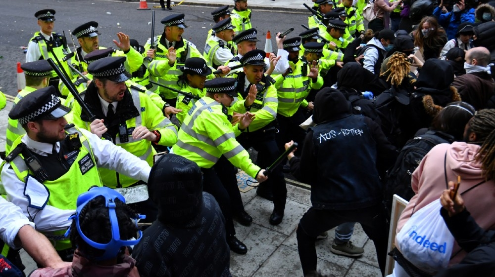 Police clash with demonstrators in Whitehall during a Black Lives Matter protest in London, following the death of George Floyd who died in police custody in Minneapolis,