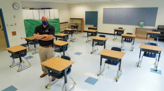 Desks are spaced to prevent the spread of the coronavirus disease (COVID-19) in a classroom in Virginia