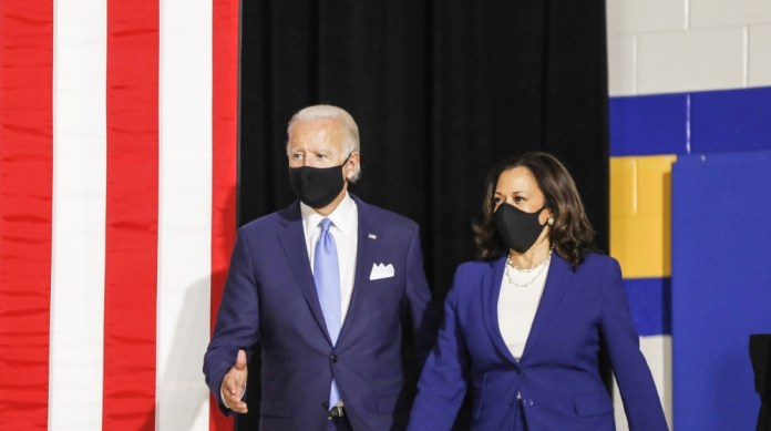 Former Vice President Joe Biden, presumptive Democratic presidential nominee, left, and Senator Kamala Harris, presumptive Democratic vice presidential nominee, wear protective masks while arriving to