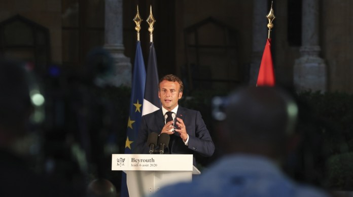 French President Emmanuel Macron delivers his speech during a press conference in Beirut, Lebanon, Thursday Aug.6, 2020. The blast, which killed more than 130 people, wounded thousands and left tens o