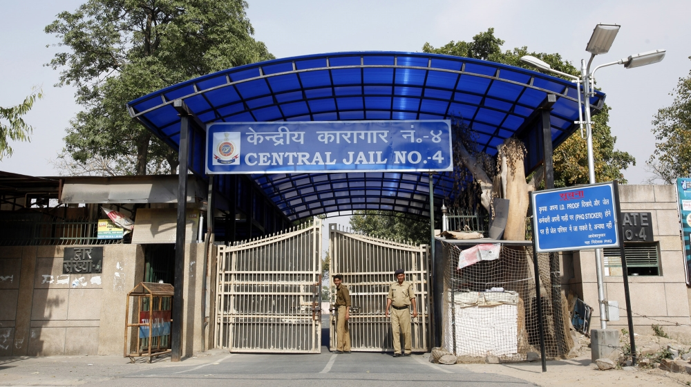 Police stand guard at one of the gates of the Tihar Jail in New Delhi March 11, 2013. The driver of the bus in which a young Indian woman was gang-raped and fatally injured in December hanged himself