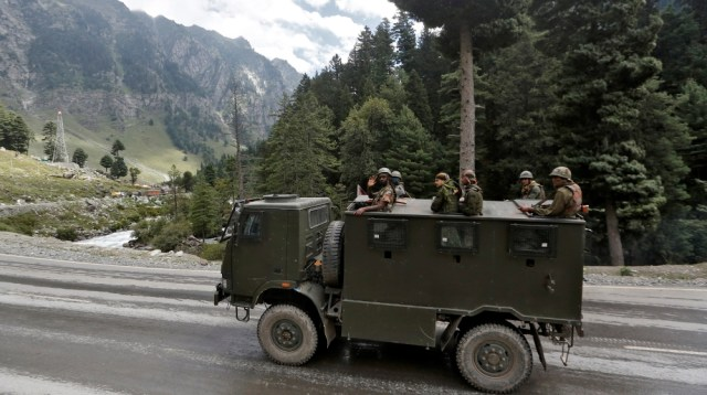 Indian army soldiers are seen atop a vehicle on a highway leading to Ladakh, at Gagangeer in Kashmir's Ganderbal district September 2, 2020. REUTERS/Danish Ismail