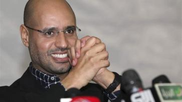 Saif al-Islam Gaddafi's decision to run for the presidency has divided Libyans [EPA]