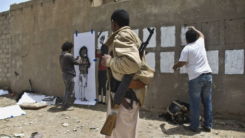 Subay's artwork frequently attracts the attention - and comments - of passersby [Majd Fuad/Al Jazeera]