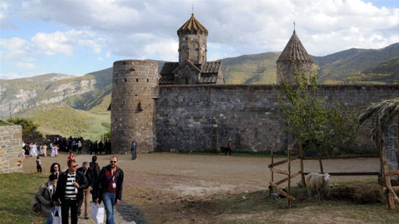 Tourists visit the ancient Tatev monastery in Armenia's southern mountains near the Iranian border [AFP]