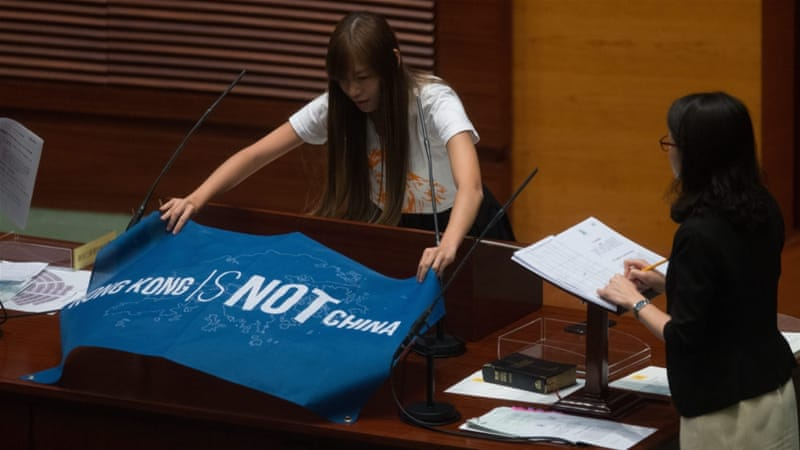 Yau Wai-ching, an elected MP, unfurled a flag that reads ''Hong Kong is not China'' during the oath taking session [EPA]