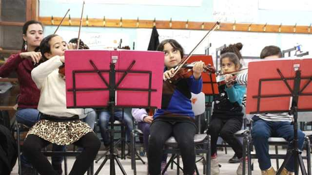 Children between the ages of five and nine learn how to play musical instruments such as the clarinet, cello and violin [Julie Ovgaard/Al Jazeera]