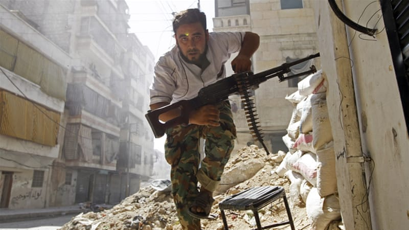 Syrian fighter during a battle with government forces [Reuters]