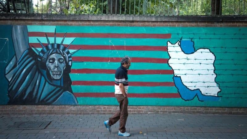 A man walks past an anti-US mural in Iran's capital, Tehran [Nazanin Tabatabaee Yazdi/TIMA via Reuters]
