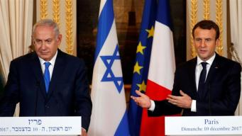 Macron (right) called on Netanyahu to negotiate with the Palestinians [Reuters]