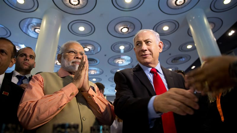 Prime Minister Narendra Modi and Israeli Prime Minister Benjamin Netanyahu meet in Tel Aviv in July [Oded Balilty/Reuters]