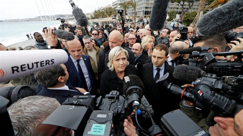 French National Front leader and presidential election candidate Marine Le Pen talks to the media [Eric Gaillard/Reuters]