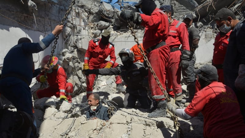 Iraqi firefighters look for bodies buried under the rubble, of civilians who were killed after an air strike against Islamic State triggered a massive explosion in Mosul, March 27 [Reuters]