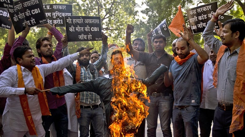 Activists of Hindu Sena protest against a government inquiry's conclusion that Mohammed Akhlaq, victim of mob lynching in Uttar Pradesh, was not storing beef for consumption [AP/Saurabh Das]