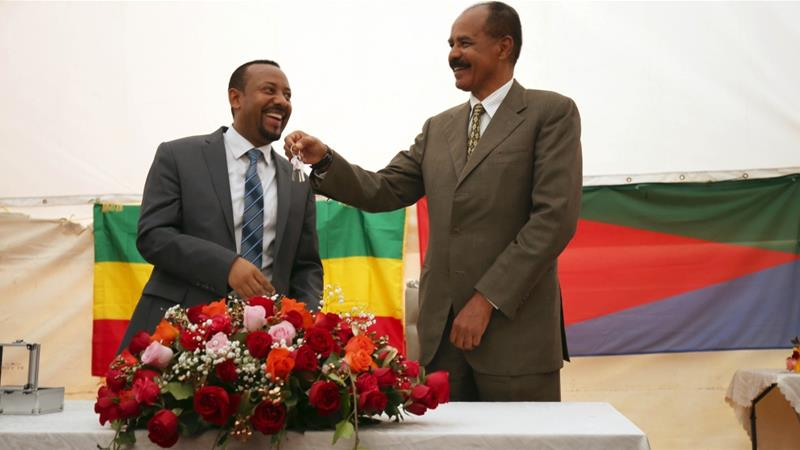Eritrea's President, Isaias Afwerki receives a key from Ethiopia's PM Abiy Ahmed during a ceremony marking the reopening of the Eritrean Embassy in Addis Ababa on July 16, 2018. [Reuters/Tiksa Negeri]