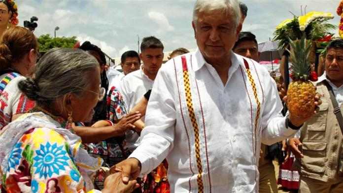 Mexico's presidential frontrunner Andres Manuel Lopez Obrador of the National Regeneration Movement (MORENA) greets supporters in Oaxaca, Mexico June 16, 2018 [Jorge Luis Plata/Reuters]