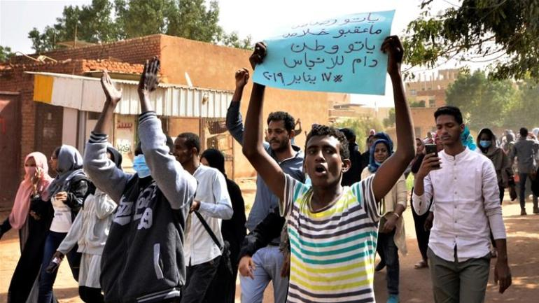 Sudanese demonstrators chant slogans during the Sudan crisis